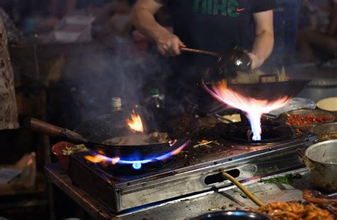 cuisine francais file wok cooking and by romainguy jpg wikimedia commons