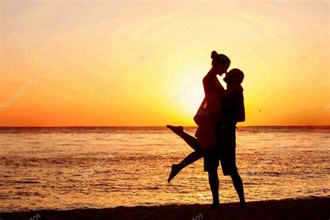 romantic couple   beach  colorful sunset