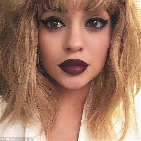 koko 02 maroon jenner puts on wig and purple lipstick for