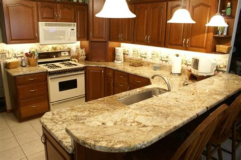 white kitchen cabinets with bordeaux granite