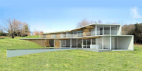 homes built into hillside green roofed tubular casa trasanquelos is built right into