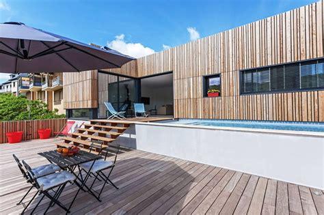 construire un ilot de cuisine maison en bois contemporaine avec piscine en toit terrasse construire tendance
