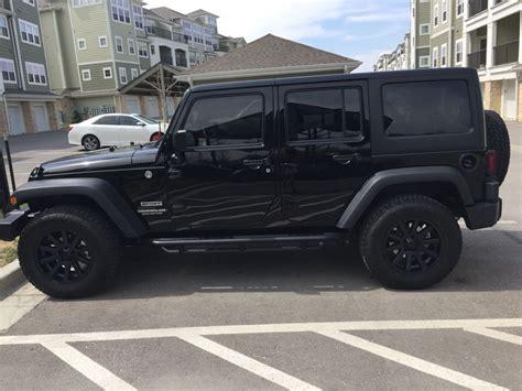 black jeep wrangler unlimited custom painted xd heist