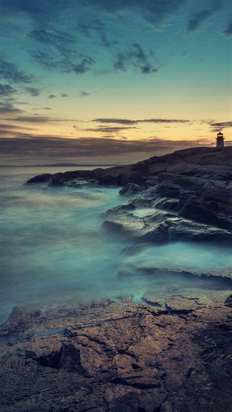 rocky ocean shore lighthouse sunset iphone  hd wallpaper