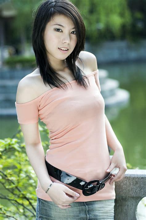 Girl Pretty Free Stock Photo A Beautiful Chinese Girl Posing Outdoors