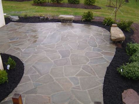 custom irregular flagstone patio with boulder benches