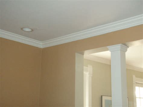 white accent cabinets with doors crown molding trim works custom carpentry