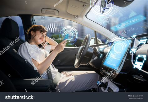 Woman Using Smart Phone Autonomous Car Stock Photo