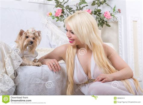 luxurious blonde woman   white dress   dog