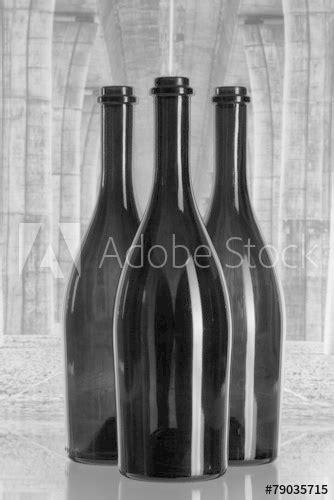 """Three wine bottles under the highway bridge"" Stock photo"