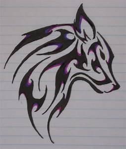 Black Ink Wolf Tribal Tattoo Design On Paper – Truetattoos