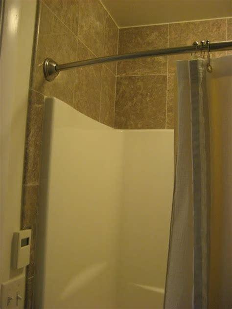 master bath tile surrounding fiberglass shower bathroom