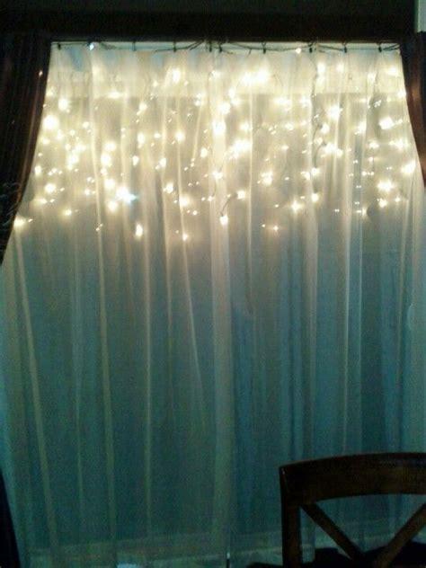 hang icicle lights   window sheer  pretty