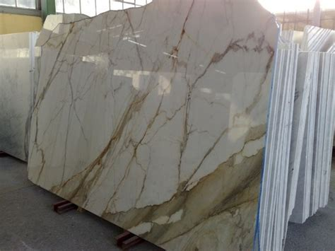 Calacatta Gold Slabs and Tiles