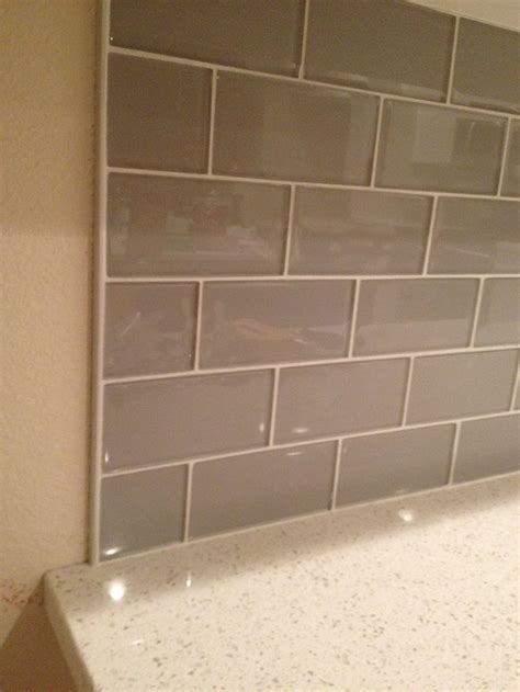 Backsplash Glass Tile Edging smoke glass backsplash with metal edging kitchen