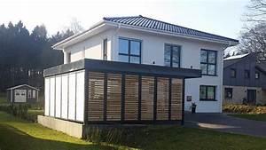 Fassade Mit Lärchenholz Verkleiden : carports d cher und schuppen aus holz ~ Lizthompson.info Haus und Dekorationen