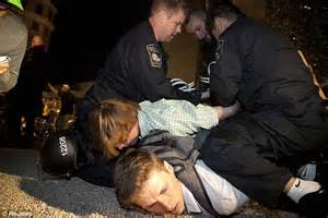 Occupy Boston: Police arrest 100 protesters and 'throw ...