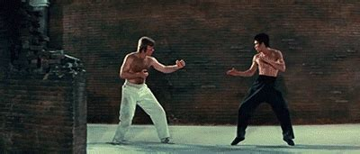 chuck norris vs bruce lee boards don t hit back bruce lee vs chuck norris way