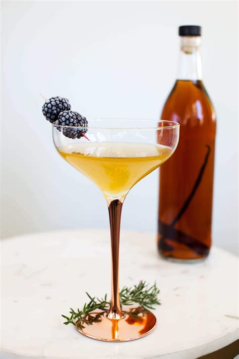 These festive cocktail recipes will have everyone feeling merry and bright at your holiday party. How to Make a Sparkling Spiced Rum Cocktail - The Awesome Muse