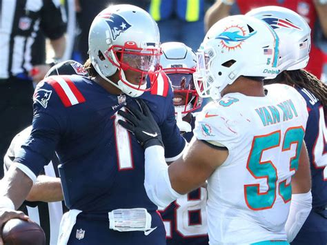 Cam says postgame scuffle started by Dolphins trying to ...
