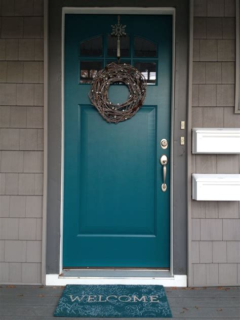 teal front door use gray shutters on the brick house