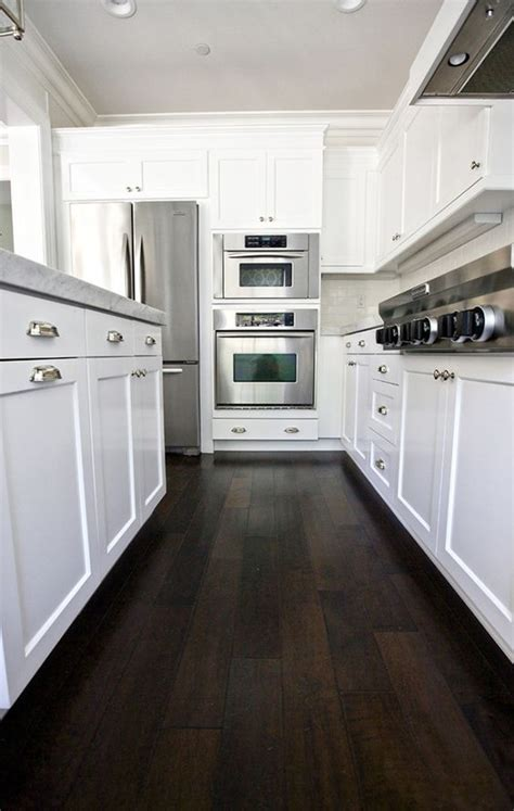 kitchen floor before or after cabinets our kitchen before after cabinets hardwood floors and 9366