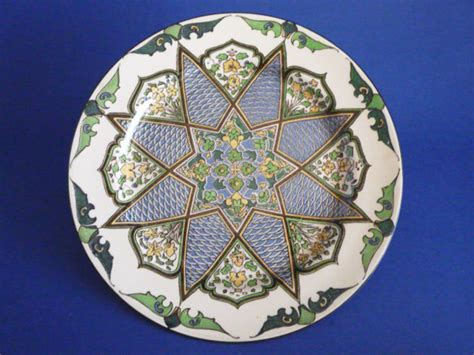 early royal doulton iznik style floral pattern  inlaid star series rack plate