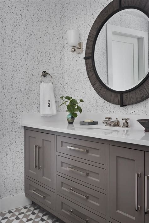 bathroom  gray wallpaper  floor tiles hgtv