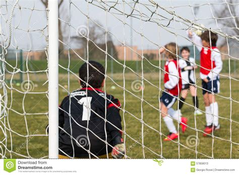 Goalkeeper, Defenders On Wall And Little Soccer Player For