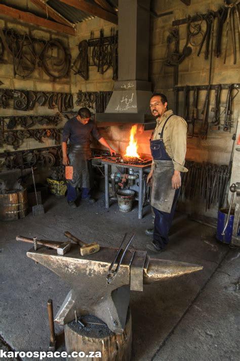 karoo blacksmith striking metal karoo space