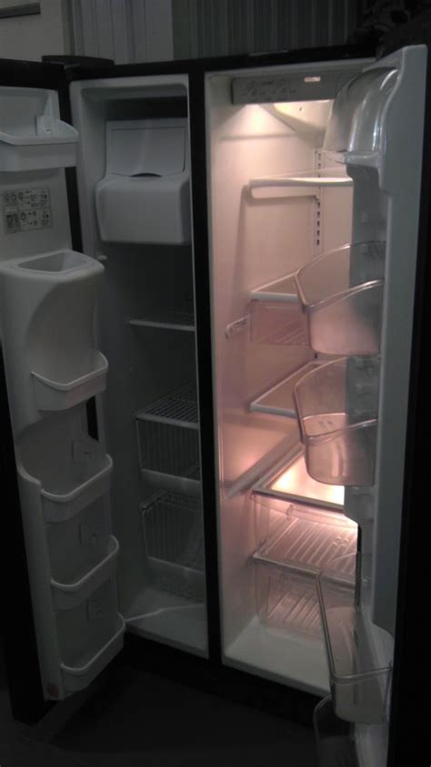 black kenmore side  side refrigerator  ice