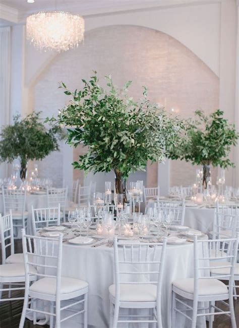 Simple and Elegant like the tall greenery centerpieces