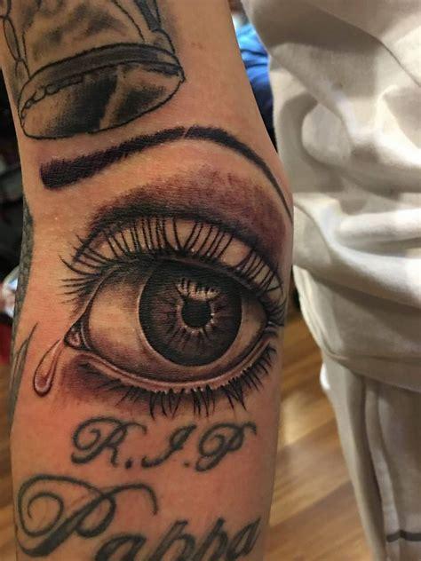 black ink eye tattoo  arm