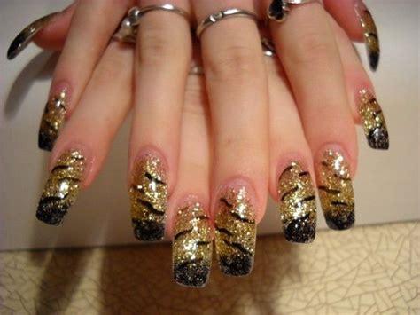 nägel schwarz gold n 228 gel fotos schwarz gold bei anya kazan nageldesign bilder by world nails nailart