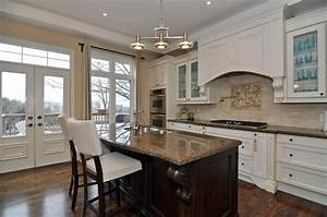 Cream kitchen cabinets with black granite countertops for Best brand of paint for kitchen cabinets with classy wall art
