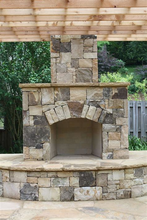 backyard fireplace outdoor stone fireplace with pergola fireplaces and firepits pinterest lakes fireplaces