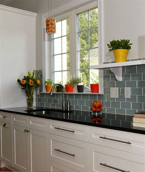 kitchen backsplash ideas white cabinets black countertops black counter top with aqua green backsplash tiles and