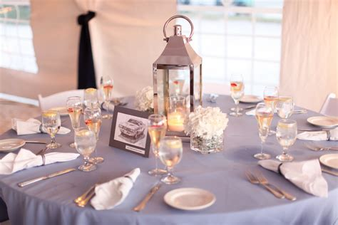 White Wedding Tables with Lanterns as Centerpieces