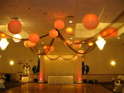fall wedding with hanging lanterns and draping over the