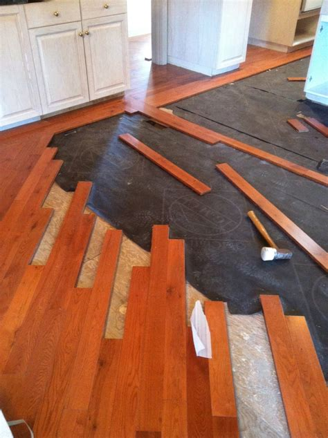 can you put wooden flooring tiles laminated wood