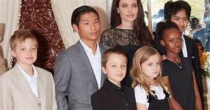 Angelina Jolie surrounded by her six children in Cambodia ...