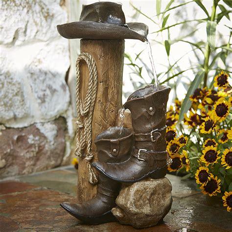 essential garden boot fountain  cowboy hat outdoor