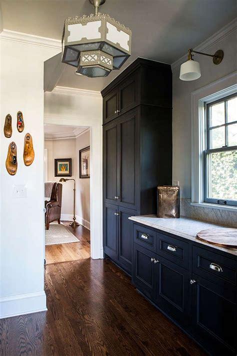 dark blue kitchen  dark wood flooring dark blue