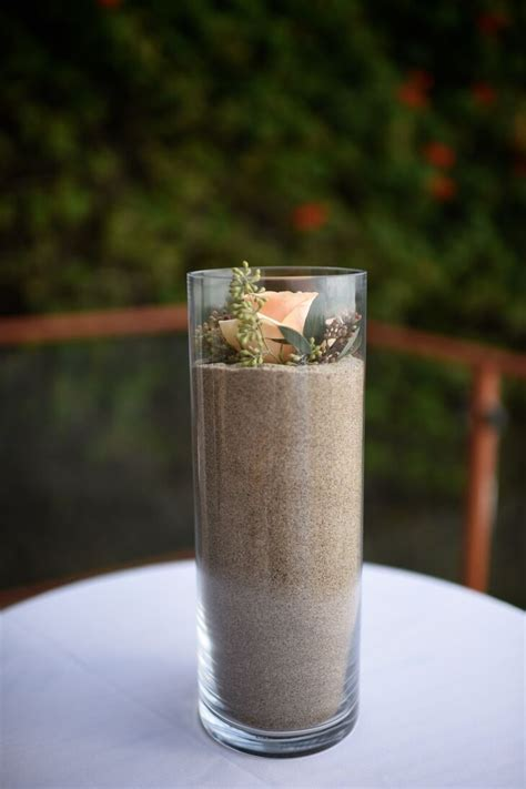 glass cylinder vase filled  sand