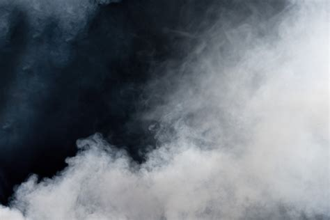 white smoke  black background isolated wall mural