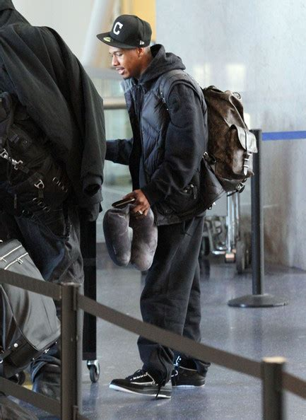 nick cannon wearing louis vuitton christopher backpack