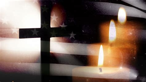 memorial day cross   flag   candle stock