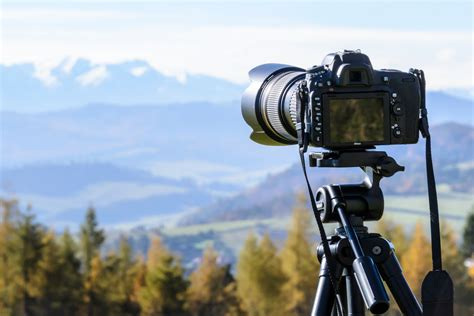 Black Dslr Camera Mounted On Black Tripod · Free Stock Photo