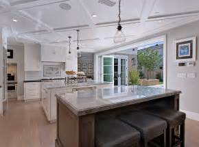 kitchens with two islands neutral cape cod style home with open layout home bunch interior design ideas