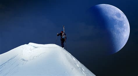 man trekking  mountain covered  snow  stock photo